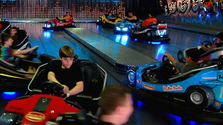 Kid driving a bumper car at Adventureland